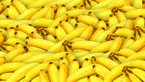 Piles of bananas bunched together